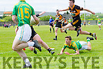 Austin Satcks Fearghal MacNamara sailing through he air to avoid South Kerry's Fionan Clifford on the ground who gets the pass away to Sean Cournane who in turn sets up Ian Galvin to score a goal.