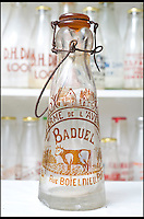 BNPS.co.uk (01202 558833)<br /> Pic: RachelAdams/BNPS<br /> <br /> An elegant vintage French milk bottle from the 1920s. <br /> <br /> In a glass of his own...<br /> <br /> Dairy-daft Peter Hayward is udderly devoted to his bizarre hobby - collecting vintage milk bottles.<br /> <br /> The 70-year-old has devoted the last 30 years to building up a whopping collection of more than 1,000 bottles.<br /> <br /> Peter, a former dairy worker, scours the south west of Britain in search of rare bottles emblazened with the colourful logos of old dairies.<br /> <br /> And since retiring 16 years ago his collection has swelled so much that he has been forced to turn his garage into a mini museum.<br /> <br /> Peter's obsession with milk started as a 10-year-old when he helped his local milkman on his weekend rounds to earn some pocket money.<br /> <br /> He later joined Express Dairies as a distribution manager, working alongside hundreds of independent dairy farmers.<br /> <br /> When he retired in the late 1990s Peter had amassed a sizeable collection in his office - and decided to devote his free time to growing it.