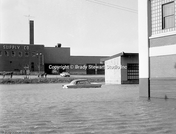 Pittsburgh PA:  View of the high water from the Allegheny River near River Avenue and the General Electric Supply building on the North Side - 1959.