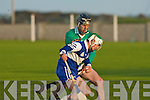 St Brendan's Chris Wallace try's to force his way past Lady's Walk's Tomas Rourke in the NK Intermediate Hurling Final at the Kilmoyley Hurling Club grounds on Monday night.    Copyright Kerry's Eye 2008