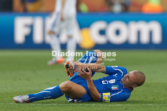 JOHANNESBURG, SOUTH AFRICA - JUNE 24:  Italy team captain Fabio Cannavaro holds his foot after being fouled during a FIFA World Cup Group F match against Slovakia at Ellis Park Stadium on June 24, 2010 in Johannesburg, South Africa.  Editorial use only.  Commercial use prohibited.  No push to mobile device usage.  (Photograph by Jonathan P. Larsen)