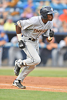 Charleston RiverDogs left fielder Estevan Florial (8) runs to first base during a game against the Asheville Tourists at McCormick Field on July 6, 2017 in Asheville, North Carolina. The Tourists defeated the RiverDogs 13-9. (Tony Farlow/Four Seam Images)