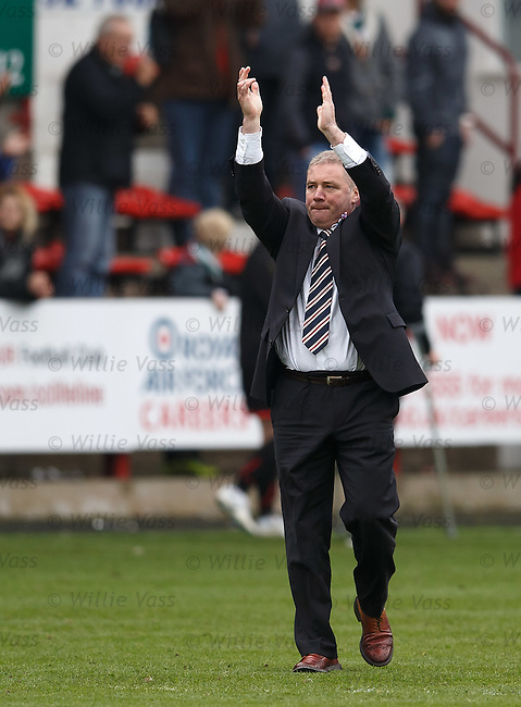 Ally McCoist applauds the travelling Rangers support after the end of their season