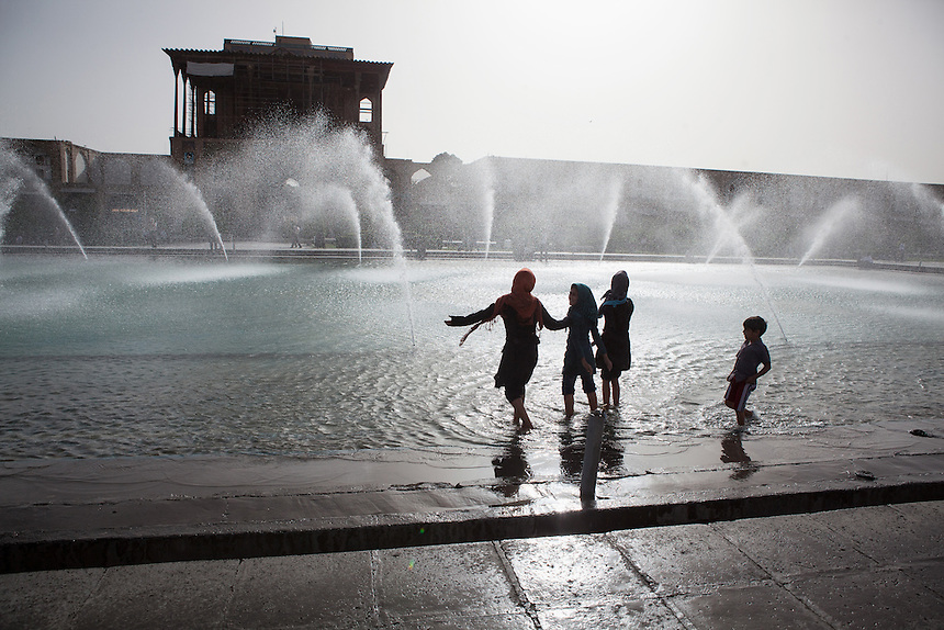 Children enjoy the pool at Imam Square. Imam Square or Naqsh-E Jahan, is a square situated at the center of Isfahan city, Iran. Constructed between 1598 and 1629, it is an important historical site, and one of UNESCO's World Heritage Sites in Iran. It is 160 meters wide by 508 meters long. The square is surrounded by buildings from the Safavid era. The Shah Mosque is situated on the south side of this square. On the west side is the Ali Qapu Palace. Sheikh Lotf Allah Mosque is situated on the eastern side of this square and the northern side opens into the Isfahan Grand Bazaar.