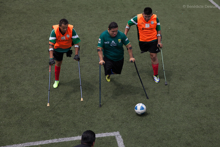"Players from Guerreros Aztecas during a game against León in Mexico City, Mexico on September 13, 2014. Guerreros Aztecas (""Aztec Warriors"") is Mexico City's first amputee football team. Founded in July 2013 by five volunteers, they now have 23 players, seven of them have made the national team's shortlist to represent Mexico at this year's Amputee Soccer World Cup in Sinaloa this December. The team trains twice a week for weekend games with other teams. No prostheses are used, so field players missing a lower extremity can only play using crutches. Those missing an upper extremity play as goalkeepers. The teams play six per side with unlimited substitutions. Each half lasts 25 minutes. The causes of the amputations range from accidents to medical interventions – none of which have stopped the Guerreros Aztecas from continuing to play. The players' age, backgrounds and professions cover the full sweep of Mexican society, and they are united by the will to keep their heads held high in a country where discrimination against the disabled remains widespread. (Photo by Bénédicte Desrus)"