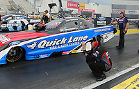 Nov. 8, 2012; Pomona, CA, USA: NHRA crew members for funny car driver Bob Tasca III during qualifying for the Auto Club Finals at at Auto Club Raceway at Pomona. Mandatory Credit: Mark J. Rebilas-