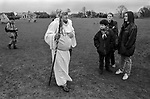 Avebury Wiltshire, Druid wedding blessings. 1996. Tourists surprised at older Druid in robes and crown of holy leaves.  British Druid Order.