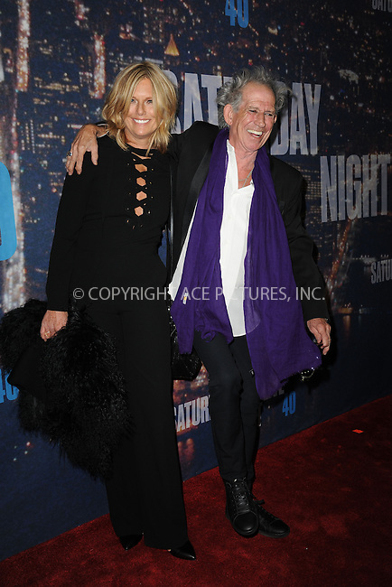 WWW.ACEPIXS.COM<br /> February 15, 2015 New York City<br /> <br /> Patti Hansen  and Keith Richards walking the red carpet at the SNL 40th Anniversary Special at 30 Rockefeller Plaza on February 15, 2015 in New York City.<br /> <br /> Please byline: Kristin Callahan/AcePictures<br /> <br /> ACEPIXS.COM<br /> <br /> Tel: (646) 769 0430<br /> e-mail: info@acepixs.com<br /> web: http://www.acepixs.com