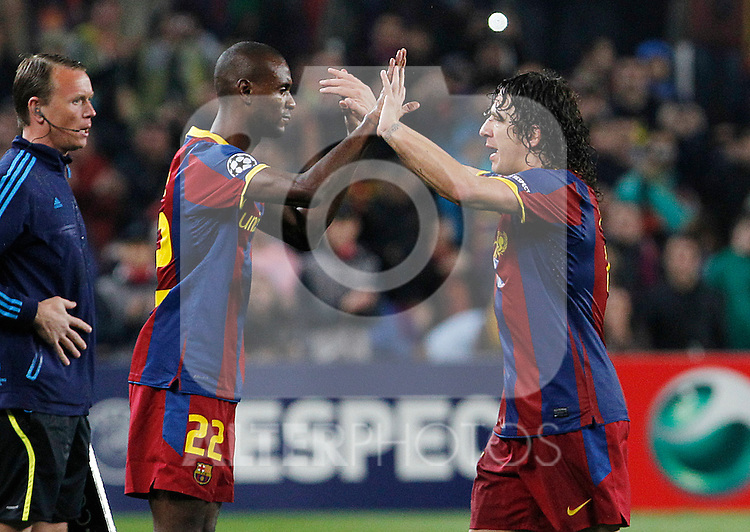 FC Barcelona's Eric Abidal (l) and Carles Puyol during UEFA Champions League match.May 3,2011.(ALTERPHOTOS/Acero)