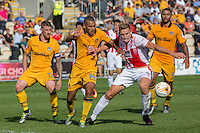 Danny Wright of Cheltenham shields the ball from Paul Bignot of Newport County during the Sky Bet League 2 match between Newport County and Cheltenham Town at Rodney Parade, Newport, Wales on 10 September 2016. Photo by Mark  Hawkins / PRiME Media Images.