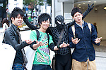 October 31, 2012, Tokyo, Japan - Japanese high school students and Black Spiderman pose for pictures during Halloween in Shibuya district, Tokyo. (Photo by Yumeto Yamazaki/AFLO)