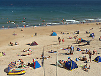 Holidaymakers sunbathing on the golden sands of the beaches around St Ives in Cornwall West Country England UK..©shoutpictures.com..john@shoutpictures.com