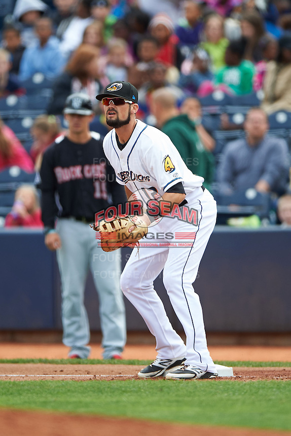Akron RubberDucks first baseman Jeremy Lucas (12) waits for a throw during a game against the New Britain Rock Cats on May 21, 2015 at Canal Park in Akron, Ohio.  Akron defeated New Britain 4-2.  (Mike Janes/Four Seam Images)