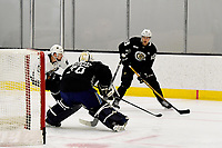 June 28, 2018: Boston Bruins forward Cedric Pare (65) sizes up a shot on goalie Jeremy Swayman (70)during the Boston Bruins development camp held at Warrior Ice Arena in Brighton Mass. Eric Canha/CSM