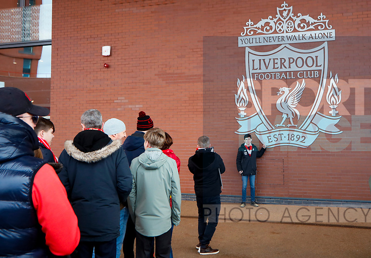 Fans take photos with the Liverpool crest during the Premier League match at Anfield, Liverpool. Picture date: 1st February 2020. Picture credit should read: James Wilson/Sportimage
