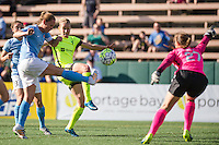 Seattle, WA - Sunday, April 17, 2016: Seattle Reign FC forward Beverly Yanez (17) has her ball cleared out by Sky Blue FC defender Christie Rampone (3) during the second half of the match. Sky Blue FC defeated the Seattle Reign FC 2-1 during a National Women's Soccer League (NWSL) match at Memorial Stadium.