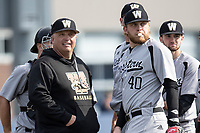 Western Michigan Broncos head coach Billy Gernon and Sean O'Keefe (40) on the mound during a pitching change against the Michigan Wolverines on March 18, 2019 in the NCAA baseball game at Ray Fisher Stadium in Ann Arbor, Michigan. Michigan defeated Western Michigan 12-5. (Andrew Woolley/Four Seam Images)