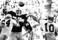 Oakland Raider defensive end Charles Philyaw against Seattle QB Jim Zorn...(1977 photo/Ron Riesterer)