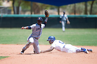 AZL Padres 2 shortstop Jordy Barley (55) shows the ball after applying the tag to Rolando Lebron (13) on a stolen base attempt during an Arizona League game against the AZL Dodgers at Camelback Ranch on July 4, 2018 in Glendale, Arizona. The AZL Dodgers defeated the AZL Padres 2 9-8. (Zachary Lucy/Four Seam Images)