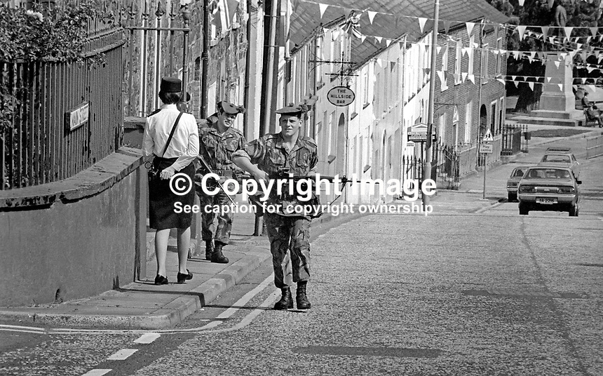 Hillsborough, Co Down, N Ireland, 10th August 1977 - Hillsborough Castle, where visiting royals stays whilst visiting N Ireland is in the centre of this picturesque Ulster village. But the Silver Jubilee visit to the Province of Queen Elizabeth II meant increased security. Normally a constable on the beat would be unusual but for armed soldiers on patrol is a rate occurence. 197708100074f <br /> <br /> Copyright Image from Victor Patterson, 54 Dorchester Park, Belfast, UK, BT9 6RJ<br /> <br /> Tel: +44 28 9066 1296<br /> Mob: +44 7802 353836<br /> Voicemail +44 20 8816 7153<br /> Email: victorpatterson@me.com<br /> Email: victorpatterson@gmail.com<br /> <br /> IMPORTANT: My Terms and Conditions of Business are at www.victorpatterson.com