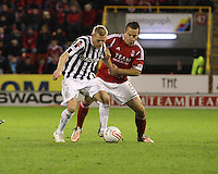 Gary Teale controls before the tackle from Gavin Rae in the Aberdeen v St Mirren Scottish Communities League Cup match played at Pittodrie Stadium, Aberdeen on 30.10.12.