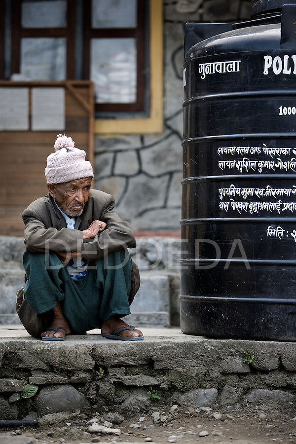 "An elderly man looks on at an ""Aged Shelter"" in Pokhara, Nepal. The shelter is a place for seniors to live who have no other family members to look after them. The shelter has no running water, the cooking is done over a fire, there are no nurses or doctors, no heating, and no medication available for the residents."