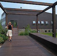 A system of ramps was included in the design of the house to link the upper living areas with the outdoors