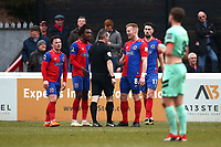 Dagenham players protest after a penalty is awarded against them during Dagenham & Redbridge vs Gateshead, Vanarama National League Football at the Chigwell Construction Stadium on 16th February 2019