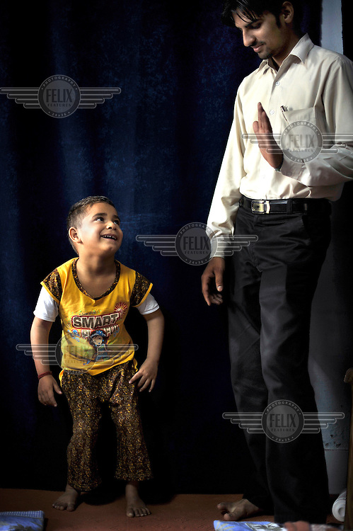 A child with birth defects is treated by a doctor at the privately funded Baba Farid Centre in Faridkot. An increasing and ignored percentage of children are being born suffering the side effects of industrial pollution. The Baba Farid Centre was set up by Dr Pritpal Singh and is staffed on a volunteer basis by his network of similarly concerned fellow junior doctors and specialists. It treats its patients with a mixture of homeopathic, ayurvedic and acupuncture methods.