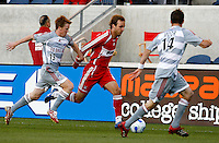 FC Dallas midfielder Dax McCarty (13) tries to hold up Chicago Fire midfielder Justin Mapp (21) as FC Dallas defender Drew Moor (14) comes over to help.  FC Dallas defeated the Chicago Fire 2-1 at Toyota Park in Bridgeview, IL on May 17, 2007.