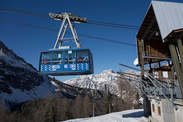 Italy, Dolomites.  <br /> Move the World by Walking.<br /> If the camera were just inches lower, the ski tram would not have cut-off the top of the distant peaks. <br /> Cortina Ski Area, Dolomites, Italy.