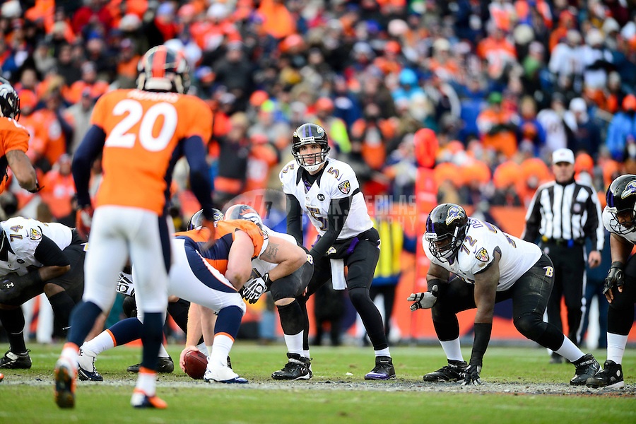 Jan 12, 2013; Denver, CO, USA; Baltimore Ravens quarterback Joe Flacco (5) prepares to take the snap in the first half against the Denver Broncos during the AFC divisional round playoff game at Sports Authority Field.  Mandatory Credit: Mark J. Rebilas-