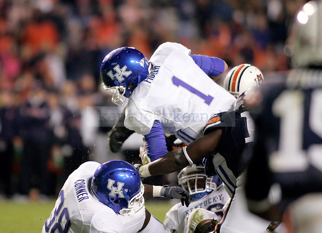 UK quarterback Will Fidler penetrates Auburn's defense in the second half of the game at the Jordan-Hare Stadium Saturday. .Photo by Zach Brake   Staff
