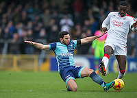 Sam Wood of Wycombe Wanderers tackles Enzio Boldewijn of Crawley Town during the Sky Bet League 2 match between Wycombe Wanderers and Crawley Town at Adams Park, High Wycombe, England on 25 February 2017. Photo by Andy Rowland / PRiME Media Images.
