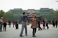 "Meishan, Sichuan province, China, October 2014 - Residents practice ballroom dance outside the Three Su Museum which was built to commemorate famous Song dynasty poet and politician Su Dongpo and his father and brother who were also notable writers (the ""three Su""). Su Dongpo was native of Meishan."
