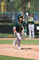 Oakland Athletics first baseman Alfonso Rivas (26) starts down the first base line after hitting a home run during an Instructional League game against the Los Angeles Dodgers at Camelback Ranch on October 4, 2018 in Glendale, Arizona. (Zachary Lucy/Four Seam Images)