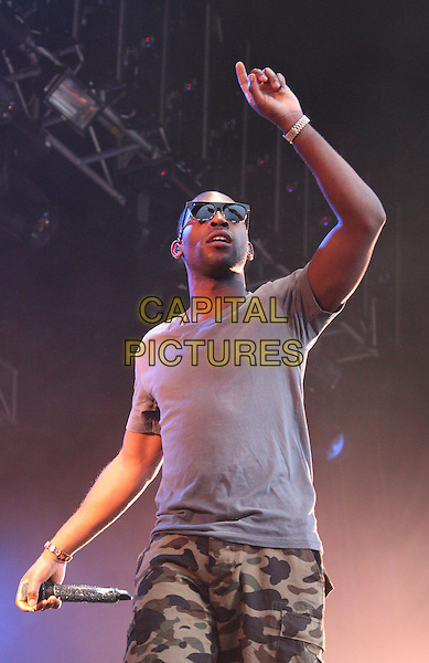Tinie Tempah (Patrick Chukwuem Okogwu Jr.).Ultrasound Music Festival at Tamworth Castle, Staffordshire, Tamworth, Staffs, USA..September 3rd 2011.stage concert live gig performance music half length grey gray t-shirt hand arm in air green camouflage shorts sunglasses shades .CAP/JIL.©Jill Mayhew/Capital Pictures