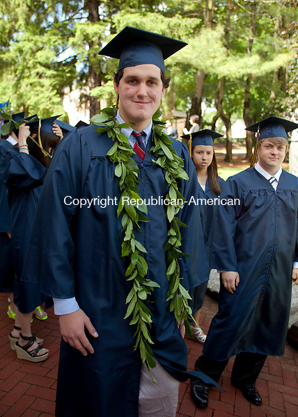 CHESHIRE, CT-8 June 2013-060813BF07-  Nick Lewis,18, from West Greenwich, RI, wears what he said was a traditional Hawaiian graduation lei during Cheshire Academy's graduation at the Kevin Slaughter Field on the Cheshire campus. Lewis will be attending Clark University.  Bob Falcetti Republican-American