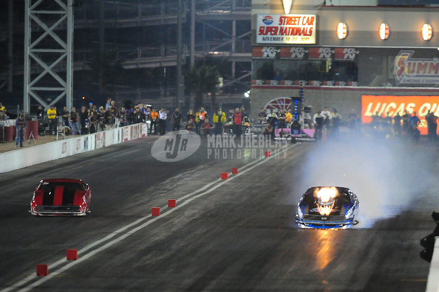 Oct. 28 2011; Las Vegas, NV, USA: NHRA pro mod driver Khalid Balooshi (right) has a nitrous explosion during qualifying for the Big O Tires Nationals at The Strip at Las Vegas Motor Speedway. Mandatory Credit: Mark J. Rebilas-US PRESSWIRE