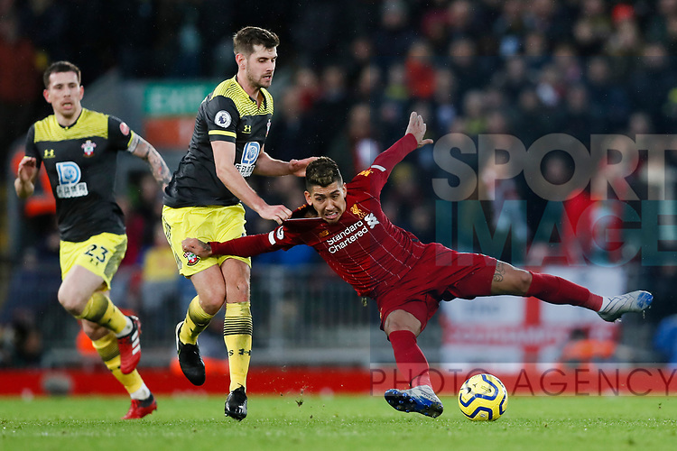 Jack Stephens of Southampton wrestles Roberto Firmino of Liverpool to the floor during the Premier League match at Anfield, Liverpool. Picture date: 1st February 2020. Picture credit should read: James Wilson/Sportimage