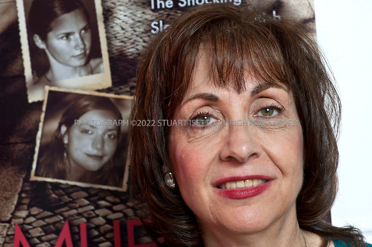 10/26/2010--Seattle, WA, USA..Candace Dempsey, the Seattle-based author of 'MURDER IN ITALY' posing in front of the book cover showing Amanda Knox and Meredith Kercher...©2010 Stuart Isett. All rights reserved.