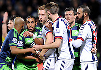 Ashley Williams of Swansea City battles with Craig Dawson of West Bromwich Albion  and Gareth McAuley of West Bromwich Albion at a corner during the Barclays Premier League match between West Bromwich Albion and Swansea City at The Hawthorns on the 2nd of February 2016