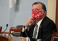 """United States Representative Tom Cole (Republican of Oklahoma) wears a protective face mask asa Director of the Centers for Disease Control and Prevention Robert Redfield testifies when Labor, Health and Human Services, Education and Related Agencies Subcommittee holds a hearing on """"COVID-19 Response on Capitol Hill in Washington, DC on Thursday, June 4, 2020.         <br /> Credit: Tasos Katopodis / Pool via CNP/AdMedia"""