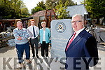 Billy Leen, Sculptor, Shane O'Callaghan, Senior Footballer, Mired Fernane, Vice Chair and Liam Lynch, Chairman with a commemorative stone to mark a century of the Austin Stacks, Football and Hurling club.