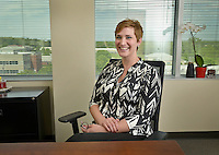 NWA Democrat-Gazette/BEN GOFF -- 05/04/15 Liz Baker, a scholarship recipient from the Single Parent Scholarship Fund of Northwest Arkansas, poses for a photo in her office at Whisinvest Realty, LLC in Rogers on Monday May 4, 2015.