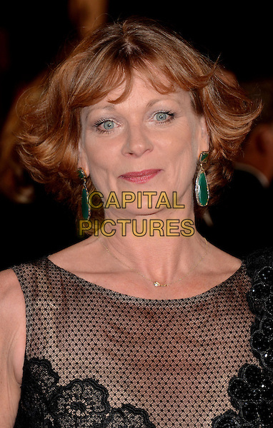 Samantha Bond.Royal World Premiere of 'Skyfall' held at the Royal Albert Hall, London, England..October 23rd, 2012.headshot portrait black lace sheer netting green dangling earrings .CAP/WIZ.© Wizard/Capital Pictures.