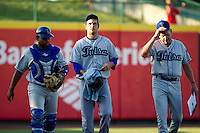 Cory Riordan (22) of the Tulsa Drillers (center) walks to the dugout with Pitching Coach Dave Schuler (21) (right) and catcher Wilin Rosario (20) (left) prior to a game against the Springfield Cardinals at Hammons Field on July 20, 2011 in Springfield, Missouri. Springfield defeated Tulsa 12-1. (David Welker / Four Seam Images)