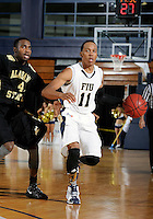 Florida International University guard Phil Taylor (11) plays against Alabama State University, which won the game 60-57 on December 3, 2011 at Miami, Florida. .