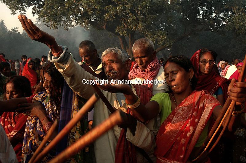 Hindu pilgrims pray to Sun god on the bank of river Gandak during Sonepur fair. Bihar, India, Arindam Mukherjee.