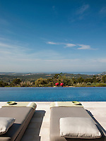 An outside terrace beside an infinity pool provides the perfect place for sun-bathing and gives a fabulous view of the countryside beyond.